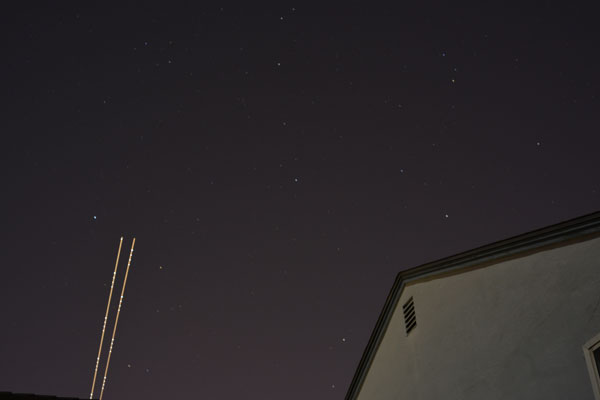 house at night with stars